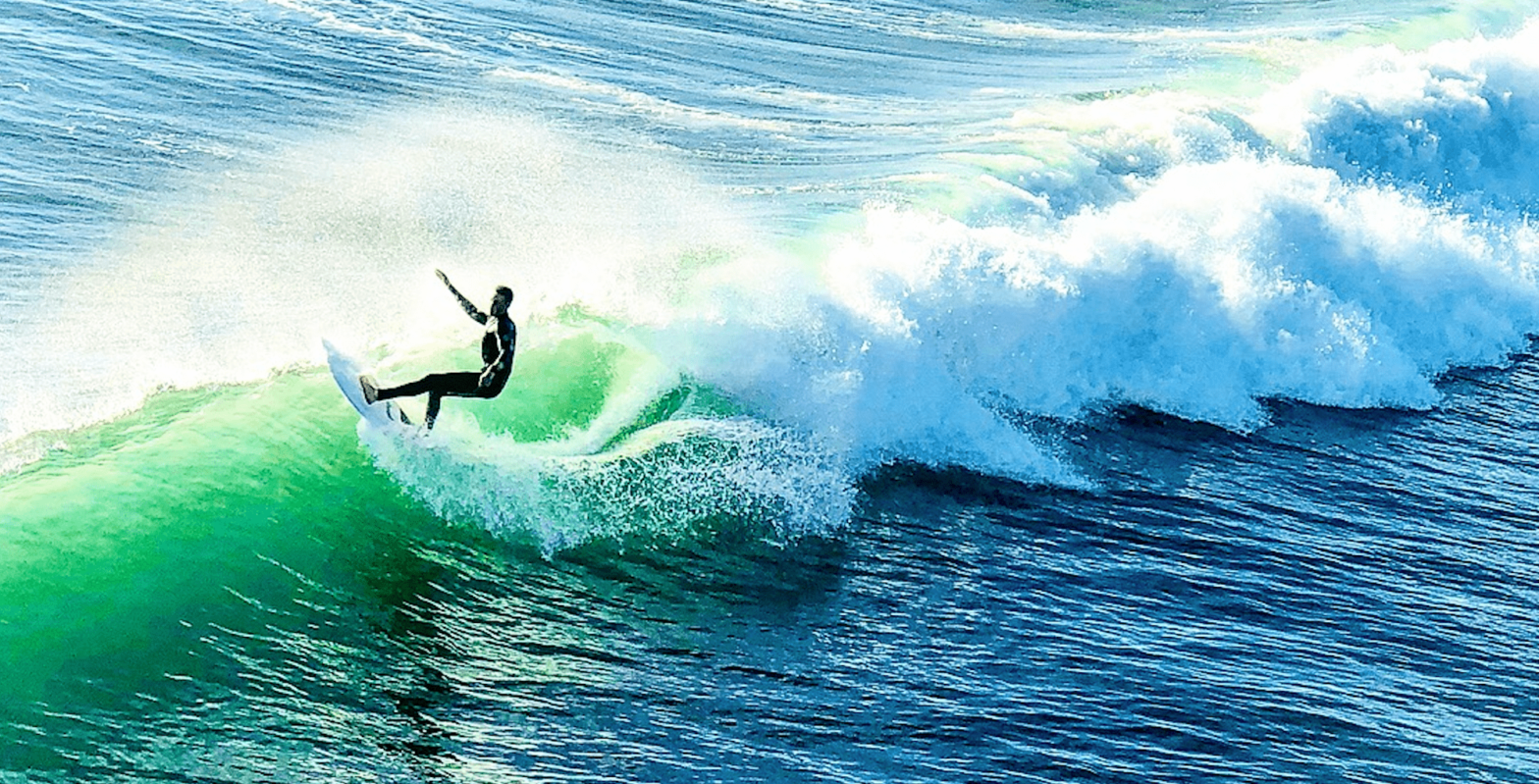 Surf Clubs of America Surfer Riding a Wave